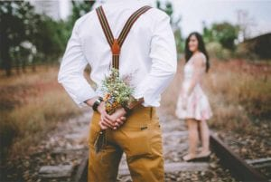 Man with flowers - how to attract a great man